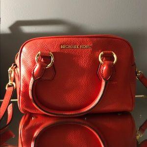 Michael kors red purse.